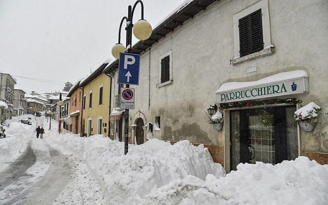 e22f78de12c9f2 People walk in the snow in Monterale s main street