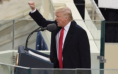 US President Donald Trump salutes the crowd after the swearing-in ceremony as 45th President of the USA in front of the Capitol in Washington on January 20, 2017. (AFP Photo/Timothy A. Clary)