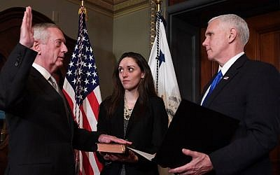 US Vice President Mike Pence, right, swears in James Mattis (L) as US Secretary of Defense in the Vice President's Ceremonial Office in the Old Executive Office Building in Washington, DC, January 20, 2017. / (AFP / JIM WATSON)