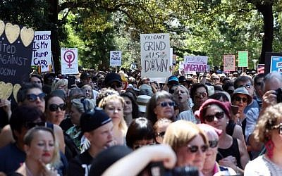 Women protesters march in a rally against US President Donald Trump following his inauguration, in Sydney on January 21, 2017. (AFP PHOTO / Andrew Murray)