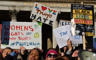 Protesters hold placards during the Women's March in Trafalgar Square in London on January 21, 2017 as part of a global day of protests against new US President Donald Trump. (AFP PHOTO/BEN STANSALL)