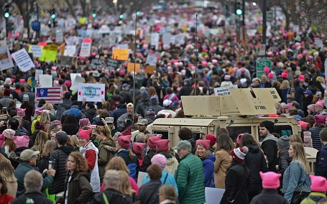 Demonstrators protest on the National Mall in Washington, DC, for the Women's March on January 21, 2017. (AFP PHOTO/Andrew CABALLERO-REYNOLDS)