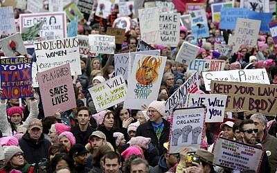 Demonstrators protest President Trump's policies regarding women during the Women's March along Pennsylvania Avenue January 21, 2017, in Washington, DC. (AFP PHOTO / Joshua LOTT)
