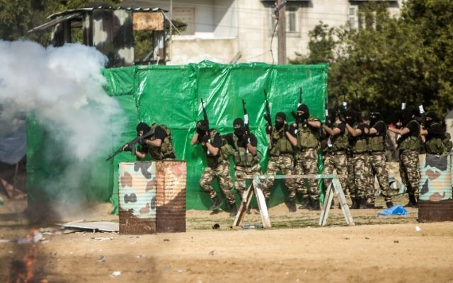Members of the Palestinian Hamas security forces stage mock raid on IDF post during a graduation ceremony in Gaza City on January 22, 2017. (AFP PHOTO / MAHMUD HAMS)