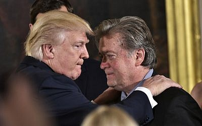 US President Donald Trump, left, congratulates Senior Counselor to the President Stephen Bannon during the swearing-in of senior staff in the East Room of the White House on January 22, 2017 in Washington, DC. (AFP/Mandel Ngan)