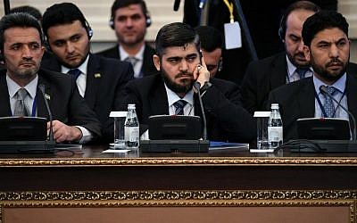 Then chief opposition negotiator Mohammad Alloush (C) of the Jaish al-Islam (Army of Islam) rebel group attends the first session of Syria peace talks at Astana's Rixos President Hotel on January 23, 2017. (AFP Photo/Kirill Kudryavtsev)