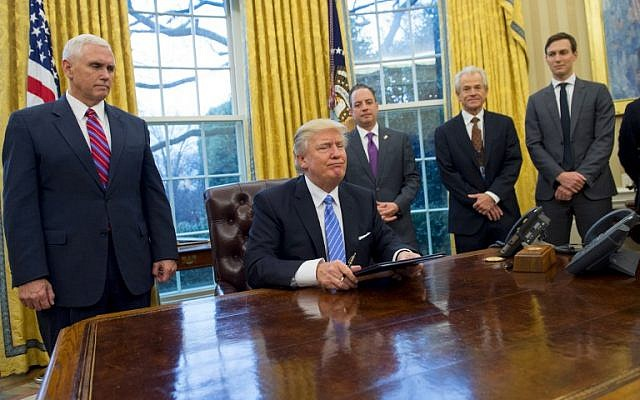 US President Donald Trump sits in the Oval Office after signing executive orders withdrawing the US from the Trans-Pacific Partnership trade deal, freezing the hiring of federal workers and hitting foreign NGOs that help with abortion, on January 23, 2017. (AFP PHOTO/SAUL LOEB)