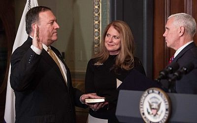 US Vice President Mike Pence, right, swears in Mike Pompeo as CIA director as his wife Susan looks on in the Vice President's Ceremonial Office at the Eisonhower Executive Office Building on January 23, 2017 in Washington, DC. (AFP/ NICHOLAS KAMM)