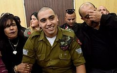 IDF soldier Elor Azaria, who was convicted of manslaughter for shooting dead a prone and wounded Palestinian assailant, in a case that has deeply divided Israel, sits with his parents as he waits for his sentence hearing at a military court in Tel Aviv January 24, 2017. (AFP/Debbie Hill)