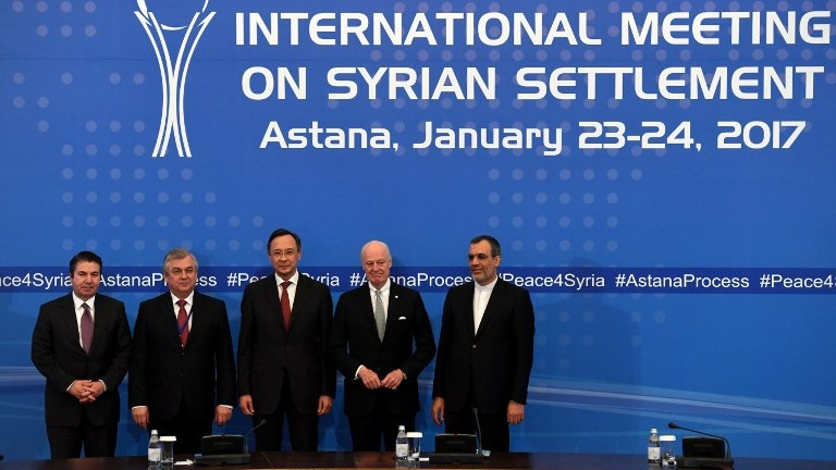 From left: Turkish Foreign Ministry Deputy Undersecretary Sedat Onal, Russia's special envoy on Syria Alexander Lavrentiev, Kazakh Foreign Minister Kairat Abdrakhmanov, UN Syria envoy Staffan de Mistura and Iran's Deputy Foreign Minister Hossein Jaber Ansari pose after the announcement of a final statement following Syria peace talks in Astana on January 24, 2017. (AFP Photo/Kirill Kudryavtsev)