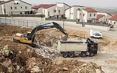 Palestinian laborers work at the construction site of a new housing project in the Israeli settlement of Ariel near the West Bank city of Nablus on January 25, 2017. (AFP Photo/Jack Guez)