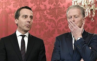 Austrias's Chancellor Christian Kern (L) and Vice-Chancellor Reinhold Mitterlehner are pictured as they offer their resignation to Austria's new President at the presidential Hofburg Palace in Vienna, Austria, January 26, 2017. (AFP PHOTO / APA / HANS KLAUS TECHT)