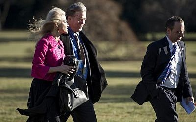 Counselor to the President Kellyanne Conway (C), Trump adviser Steve Bannon (C) and White House Chief of Staff Reince Priebus walk to the West Wing from the South Lawn to the White House in Washington, DC January 26, 2017. (AFP PHOTO/Brendan Smialowski)