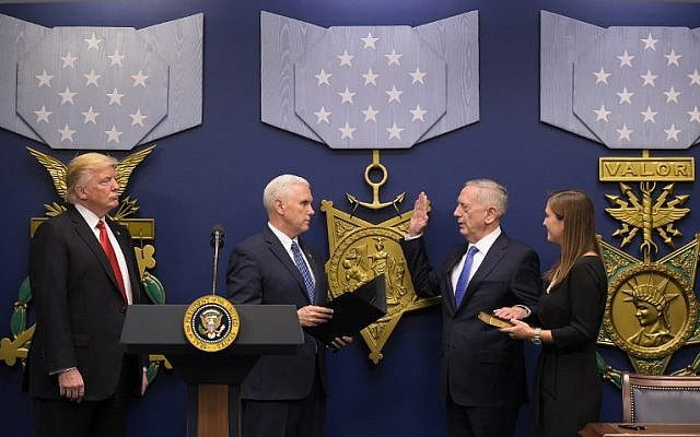 US President Donald Trump (L) watches as US Vice President Mike Pence (2nd L) administers the ceremonial swearing-in of James Mattis (2nd R) as secretary of defense on January 27, 2016 at the Pentagon in Washington, DC. (AFP/Mandel Ngan)