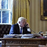 US President Donald Trump speaks on the phone with Russia's President Vladimir Putin from the Oval Office of the White House in Washington, DC on January 28, 2017. (AFP/Mandel Ngan)