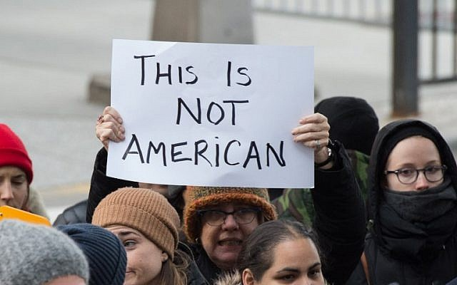Protesters gather at JFK International Airport's Terminal 4 to demonstrate against US President Donald Trump's executive order on January 28, 2017, in New York.(AFP PHOTO / Bryan R. Smith)