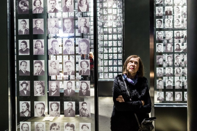 A woman looks at photographs on January 29, 2017 as part of the permanent exhibition of Museum of Second World War opened for two days ahead of the official opening planned for the end of February in Gdansk, Poland. (AFP PHOTO / Wojtek RADWANSKI)