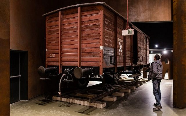 A man looks at a wagon on January 29, 2017 as part of the permanent exhibition of Museum of Second World War opened for two days ahead the official opening planned for the end of February in Gdansk, Poland. (AFP PHOTO / Wojtek RADWANSKI)