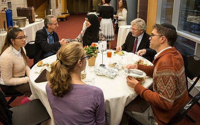 Lehigh University students, staff and faculty engage in dialogue with guest speaker Rabbi Yehuda Sarna (right) about his interfaith work, September 29, 2016. (John Kish)