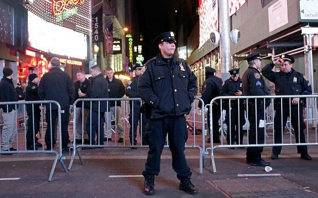 Police congregate in the lead-up to New Year's Eve celebrations in Times Square in New York City on December 31, 2016. (Yana Paskova/Getty Images/AFP)
