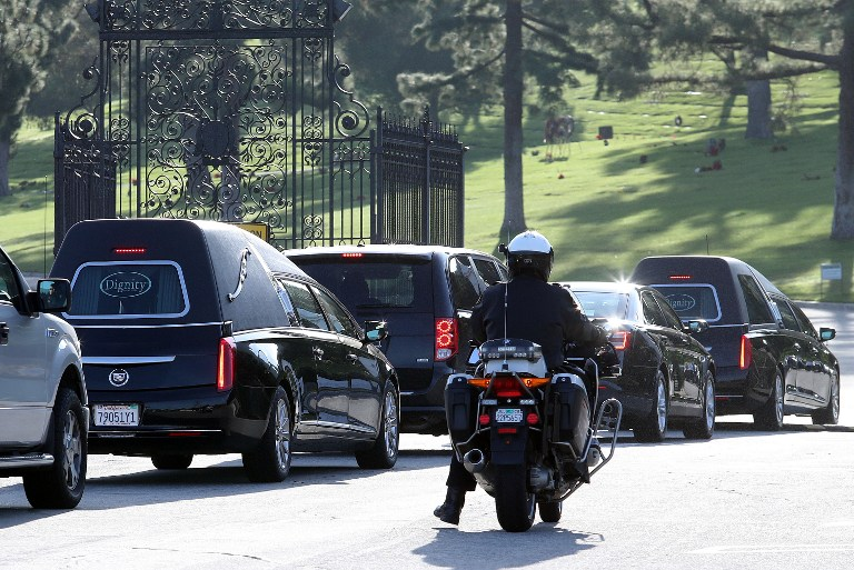 A funeral procession transports Debbie Reynolds and Carrie Fisher to their joint Memorial and Funeral at Forest Lawn Cemetery on January 6, 2017 in Los Angeles, California. (Frederick M. Brown/Getty Images/AFP)