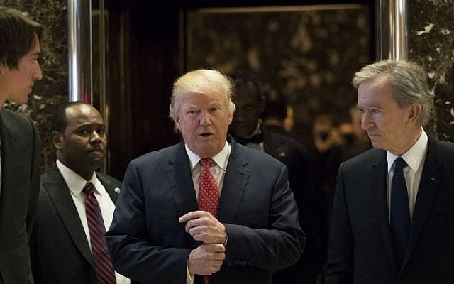 President-elect Donald Trump and French businessman Bernard Arnault, chief executive officer of LVMH, emerge from the elevators to speak to reporters at Trump Tower, January 9, 2017 in New York City. (Drew Angerer/Getty Images/AFP)