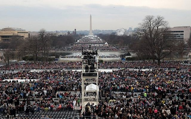 Spectators fill the National Mall in front of the U.S. Capitol on January 20, 2017 in Washington, DC. (Scott Olson/Getty Images/AFP)