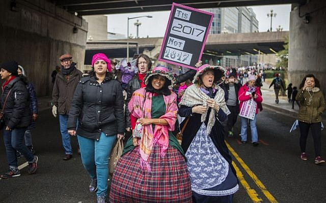 Protesters dressed in 19th century attire attend the Women's March in Washington DC on January 21, 2017 (Jessica Kourkounis/Getty Images/AFP)