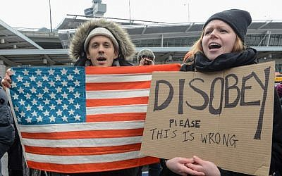 Protesters gather at JFK International Airport in New York on January 28, 2016, to demonstrate against US President Donald Trump's executive order suspending refugee arrivals and imposing tough controls on entry from 7 Muslim states. (Stephanie Keith/Getty Images/AFP)