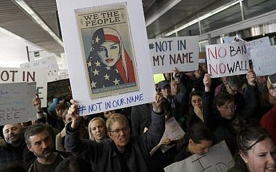 Demonstrators hold signs during a rally against a ban on Muslim immigration at San Francisco International Airport on January 28, 2017 in San Francisco, California. ( Stephen Lam/Getty Images/AFP)
