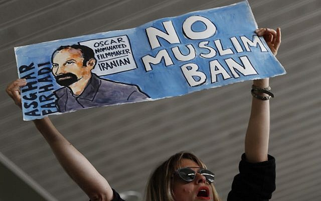 A woman holds a sign during a rally against a ban on Muslim immigration at San Francisco International Airport on January 28, 2017 in San Francisco, California. (Stephen Lam/Getty Images/AFP)