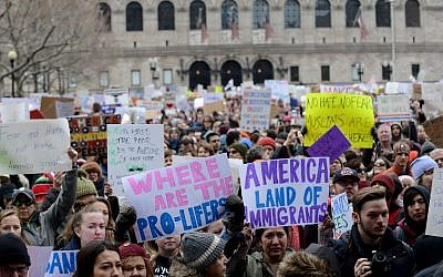 People gather in Copley Square to protest the Muslim immigration ban enacted by President Trump on January 29, 2017, in Boston, Massachusetts. (Darren McCollester/Getty Images/AFP)