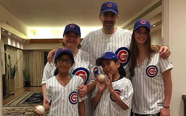 Julie Fisher, Dan Shapiro and their daughters celebrate the Chicago Cubs' Wold Series win, November 2016. (Courtesy)