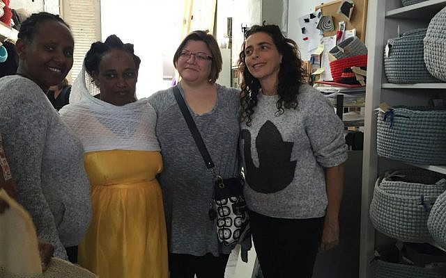 Julie Fisher (second from right) visits Kuchinate African Women's Collective in south Tel Aviv. It is a collective of women artists, many of whom are torture victims and have children with special needs. (Courtesy)