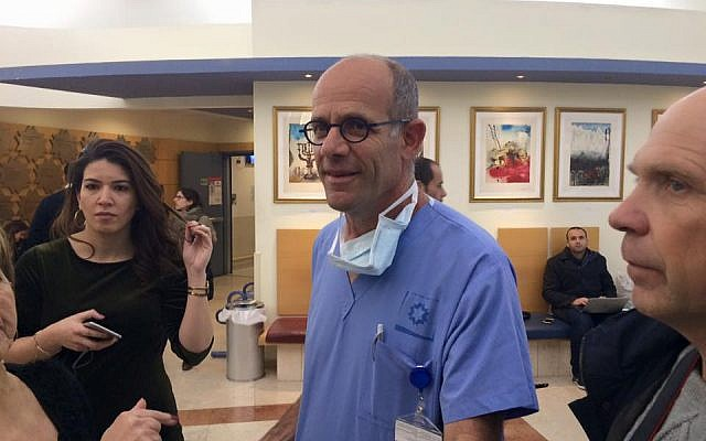 Dr. Ofer Merin speaking with reporters at Shaare Zedek medical center following a terror attack in Jerusalem, January 8, 2017. (Renee Ghert-Zand/Times of Israel)