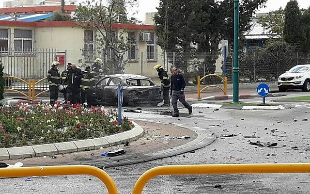 Firefighters on the scene of a car explosion on Jabotinsky Street in Kiryat Yam on January 26, 2017. One person was killed, two were injured in the incident. (Ichud Hatzala Carmel)