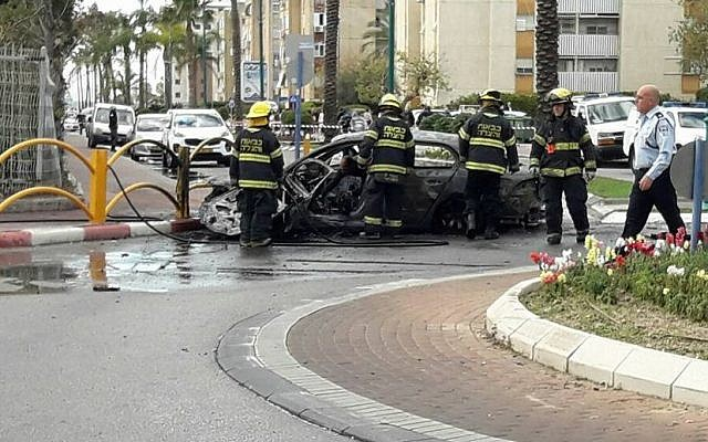 Firefighters at the scene of a car explosion in Kiryat Yam on January 26, 2017. One person was killed, two were injured in the incident.  (United Hatzala Carmel)