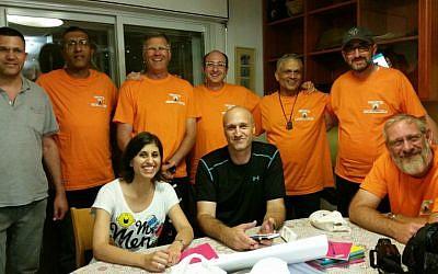 Ma'aleh video therapy bereaved fathers group. Back row (left to right): Asher Lemann (facilitator), David Cohen, Chanan Ariel, Ofir Shaer, Yosef Baruch Kalangel, Nachum Lemkus. Front row (left to right): Keren Hakak (facilitator), Menachem Assaraf, Shalom Sarel. (Courtesy of Ma'aleh)