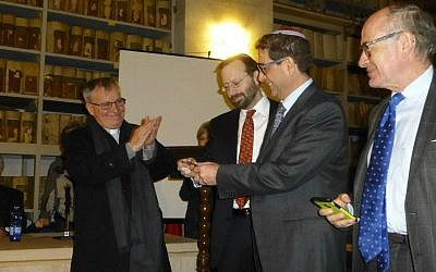From left to right: Episcopal Vicar Raffaele Mangano, who handed over the key to the former Oratory of Santa Maria Delle Grazie al Sabato on behalf of the Archbishop Corrado Lorefice, Shavei Israel chairman Michael Freund, Ariel Finzi from the Jewish Community of Naples, vice president of the Union of Italian Jewish Communities Giulio Disegni. (Courtesy)