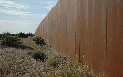 The Wall separating Mexico-US border wall, seen from the Mexico side (CC BY Wonderlane, Flickr)