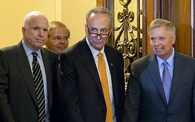 Sen. Chuck Schumer, D-N.Y., center, flanked by Sen. John McCain, R-Ariz., left, and Sen. Lindsey Graham, R-S.C., walk through the halls of Congress on Thursday, June 27, 2013 (AP Photo/J. Scott Applewhite)