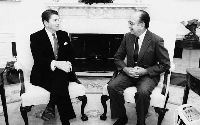 US President Ronald Reagan meets with Richard Schifter, US representative to the UN Human Rights Committee, in the Oval Office of the White House, February 2, 1984, in Washington. (AP Photo/White House Photo/Mary Anne Fackelman)