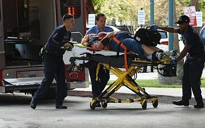 An injured woman is taken into Broward Health Trauma Center in Fort Lauderdale, Fla., after a shooting at the Fort Lauderdale-Hollywood International Airport on Friday, Jan. 6, 2017. (Taimy Alvarez/South Florida Sun-Sentinel via AP)