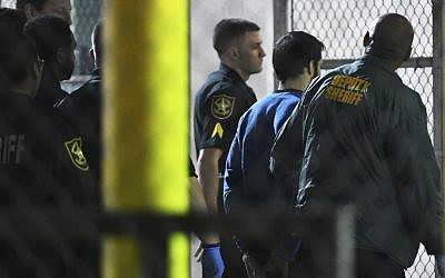 Esteban Santiago, 26, the suspect in the deadly shooting at Fort Lauderdale-Hollywood International Airport, is transported to the Broward County Main Jail by authorities, Saturday, January 7, 2017. (Jim Rassol/South Florida Sun-Sentinel via AP)