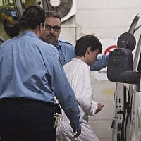 Alexandre Bissonnette is escorted to a van January 30, 2017, in Quebec City, after appearing in court for Sunday's deadly shooting at a mosque. (Jacques Boissinot/The Canadian Press via AP)