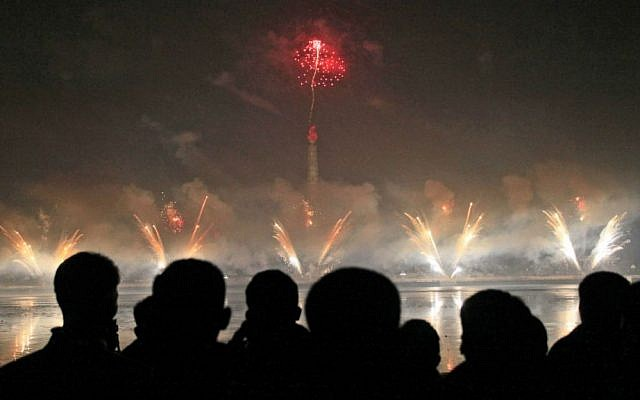 North Koreans gather to watch a New Year's fireworks display at the Kim Il Sung Square in Pyongyang, North Korea, on Sunday, Jan. 1, 2017. (AP Photo/Kim Kwang Hyon)