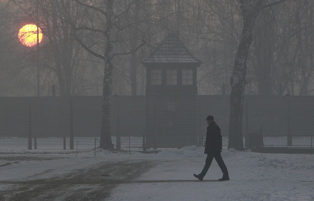 A man visits Auschwitz-Birkenau at sunrise on the 72nd anniversary of the liberation of the Nazi death camp, in Oswiecim, Poland, Friday, Jan. 27, 2017. (AP Photo/Czarek Sokolowski)