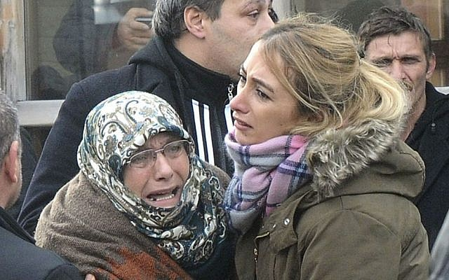 Family members of victims of an overnight terror attack at a nightclub, cry outside the Forensic Medical Center in Istanbul, Jan. 1, 2017. (Suleyman Kaya/DHA - Depo Photos via AP)