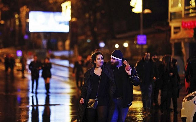 Young people leave from the scene of an attack in Istanbul, early January 1, 2017. (AP/Halit Onur Sandal)