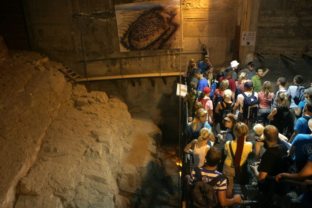 File: Tourists wait to enter the Siloam water tunnel in the east Jerusalem neighborhood of Silwan. A 2,700-year-old tablet uncovered in the ancient subterranean passage, the Siloam inscription, is held in an Istanbul museum. (AP Photo/Rachael Strecher)